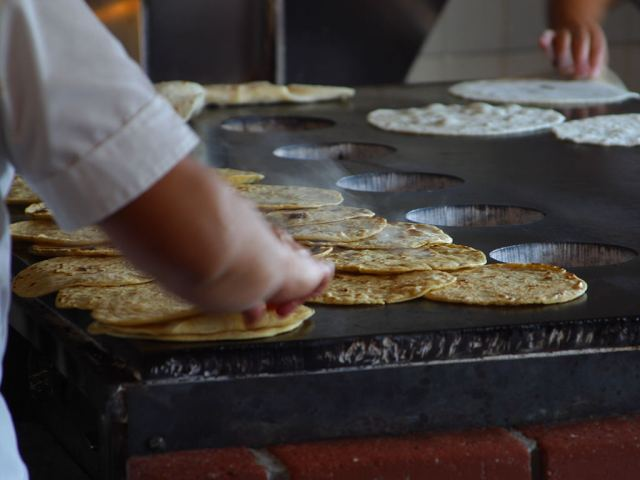 Tortillas being made in Old Town San Diego.By Jon Sullivan [Public domain], via Wikimedia Commons