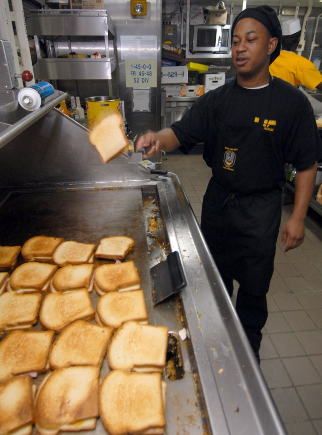 Red Sea (Aug. 21, 2006) - Culinary Specialist 3rd Class James M. Freeman prepares grilled ham and cheese sandwiches in the chief petty officers galley aboard the amphibious assault ship USS Iwo Jima (LHD 7). Iwo Jima is currently on a scheduled deployment in support of maritime security operations (MSO) in the region. U.S. Navy photo by Mass Communication Specialist Seaman Christopher L. Clark