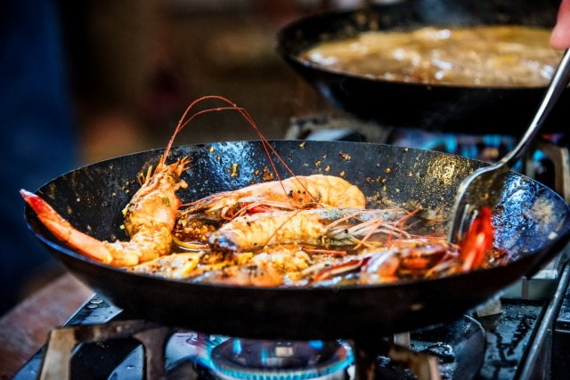 Chef Ryan Stoneware cooked shrimp for a hungry crowd at French Market Fare