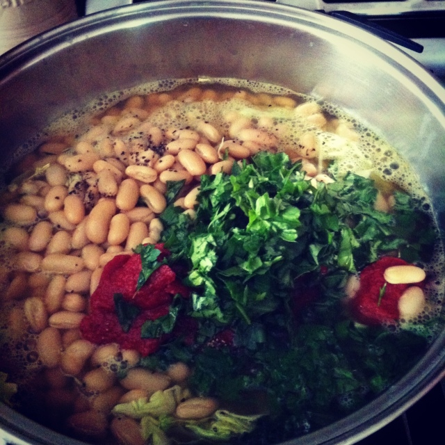 Tuscan Kale Soup simmering in a pot. Photo by Sharon Ona.