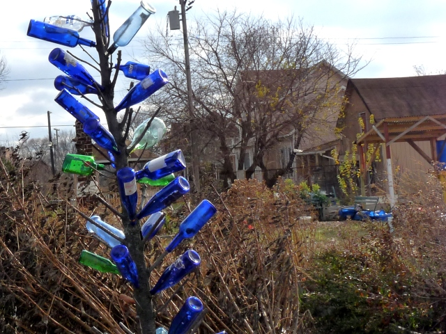 Bottle tree on an urban farm in Detroit. Photo by Yooperann, via flickr. Some rights reserved.