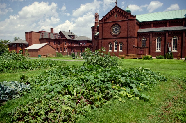 A local Catholic church displays a thriving urban garden. Photo by University of Michigan, via Flickr. Some rights reserved.