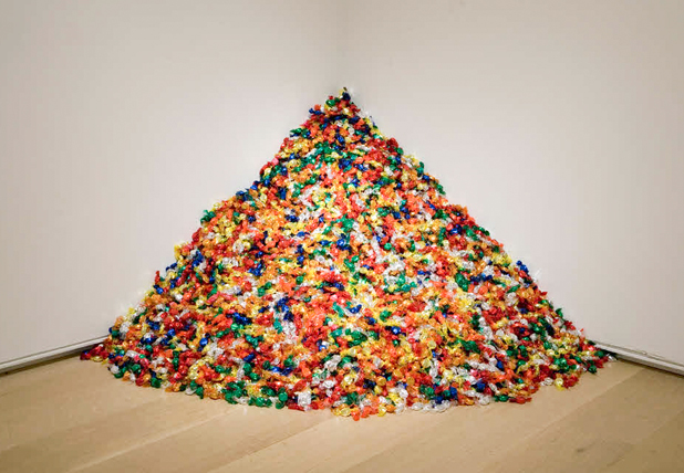 "Félix González-Torres (American, 1957–1996). ""Untitled"" (Portrait of Ross in L.A.), 1991. Candies individually wrapped in multicolored cellophane, endless supply. Overall dimensions vary with installation, ideal weight: 175 lb. The Art Institute of Chicago; promised gift of Donna and Howard Stone."
