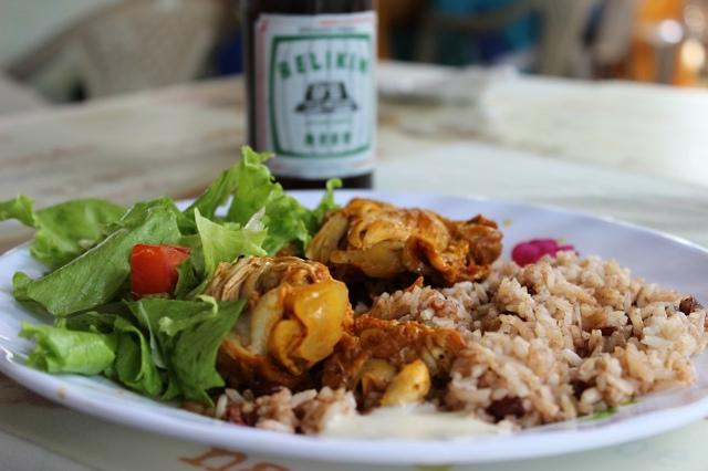 Lunch at the Black Orchid in Belize features meats, beans, rice, and local beer.