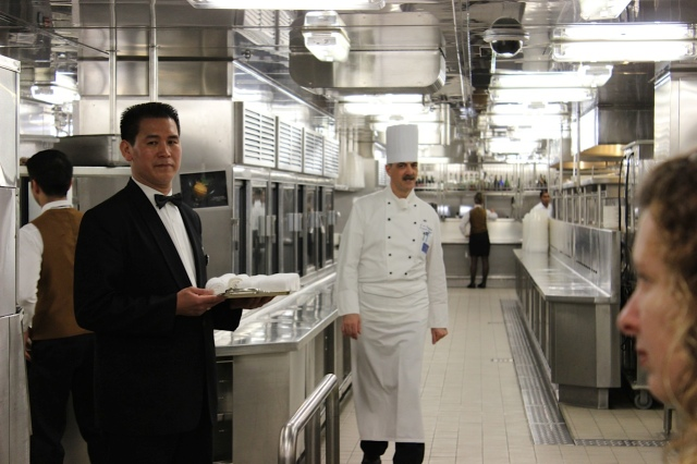 Executive Chef Giuseppe De Gennaro strolls through the corridor of a perfectly clean kitchen on the Crown Princess.