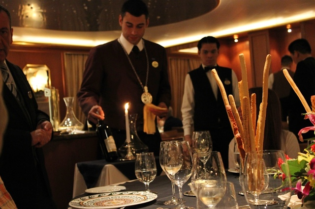 The sommelier prepares to pour wine at the Chefs Table.