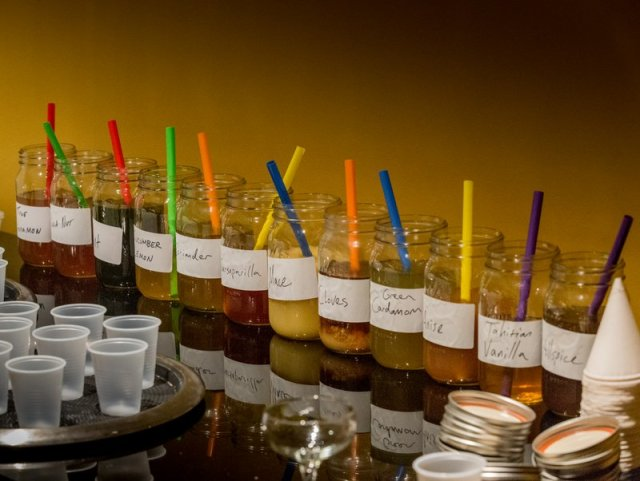 Guests used ingredients provided to mix their own bitters. Photo by Stephen Bins