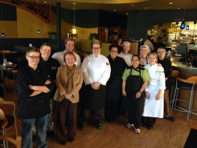 Sylvia Lovely (front, third from left) and Shannon Collins (second from left) at the Women's Chef Dinner in March
